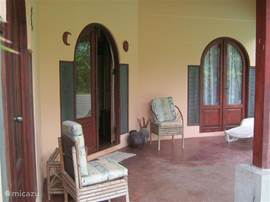 Another view of the patio with view the doubledoors of the entrance and one of the bedrooms.