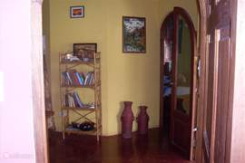 this picture shows entrance to one of the bedrooms. On the right the main entrance.
