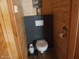 New toilet in separate room.
