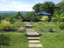 Private garden around the pool with many views about their own rice fields, to the mountains, sea etc. In the garden and villa are situated 3 bale bengongs (rest houses) to enjoy here the views.