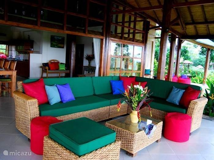Lounge seating on the veranda where you can enjoy the views and the quiet oasis. Following porch to the spacious living room with open character. As a result, you will always be aware of the nature and the many views and lovely cooling breeze