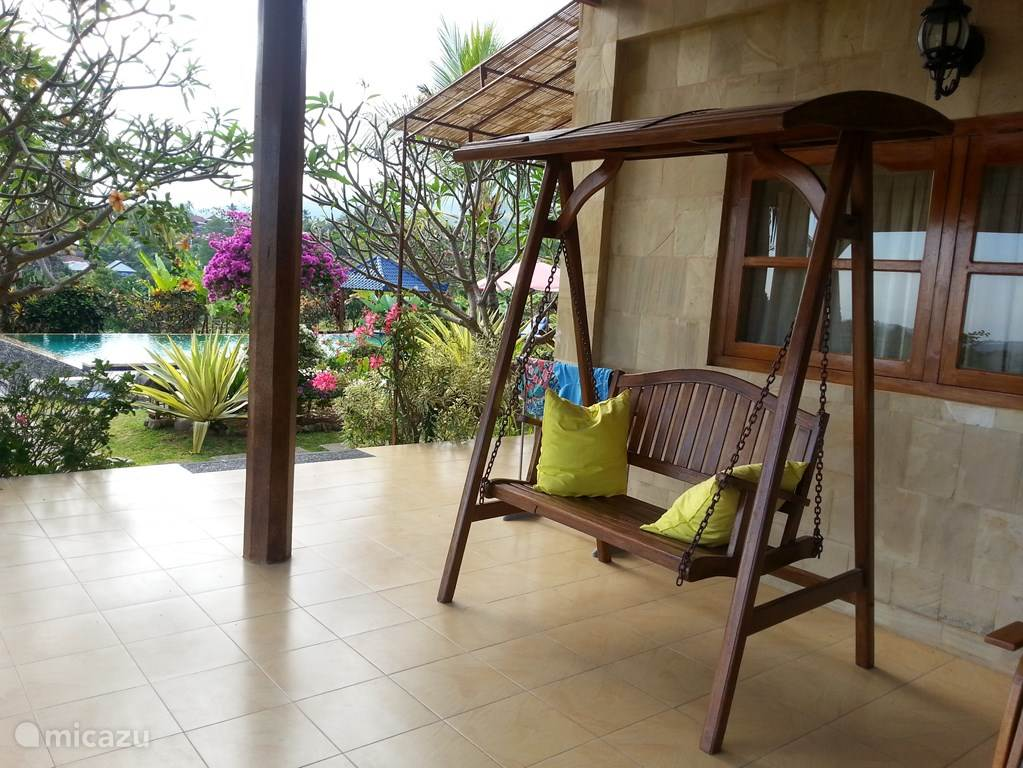 Spacious veranda around the villa with seats