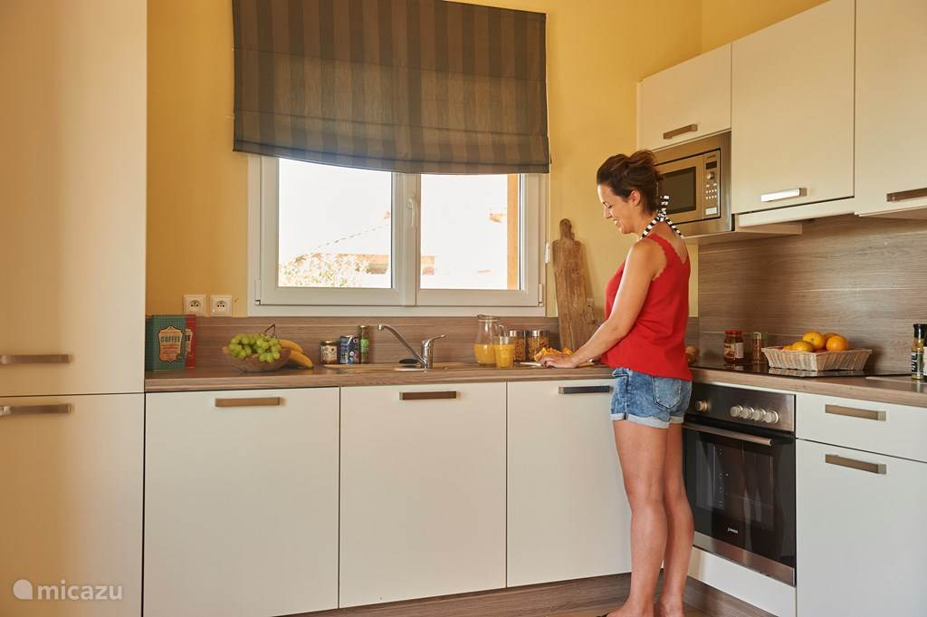 A spacious kitchen with dishwasher and microwave.