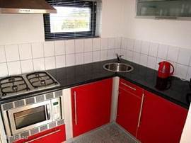 The kitchen is fully equipped. Microwave, kettle, fridge, coffee maker and plenty of plates, glasses, cups and cutlery for 6 people.