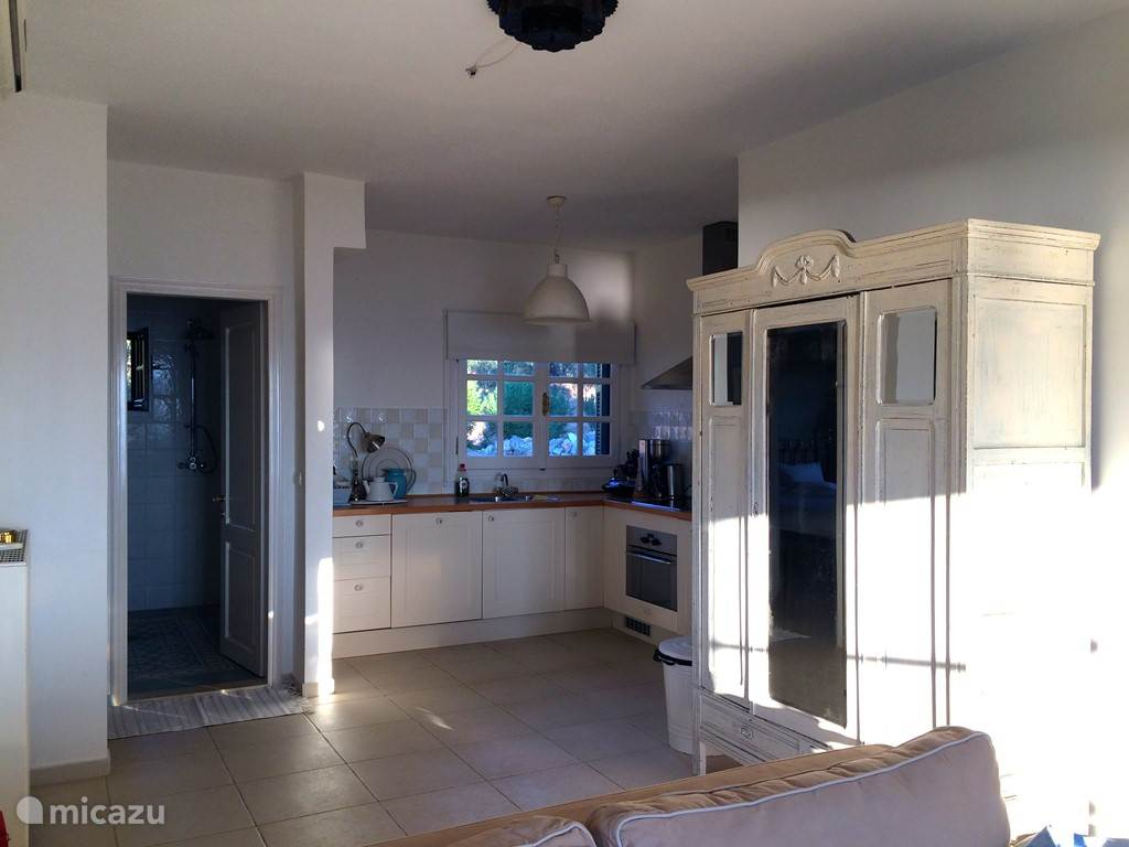 The kitchen is fully equipped including a dishwasher, oven, juicer, kettle and fridge with freezer.