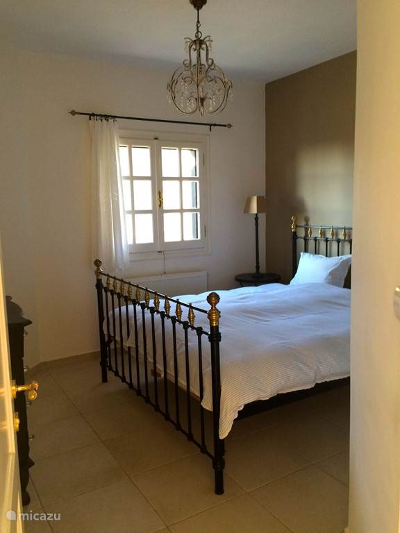 The bedroom provides an excellent double bed. Like anywhere else there are shutters to keep the sun and warmth out whenever necessary.