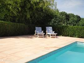 Paved patio to the pool with tiles that stay cool! Enjoy the sun, the water and the rural and quiet area!!
