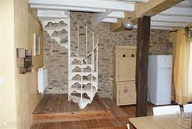 From the kitchen you can reach the 1st floor via an authentic old spiral staircase .....