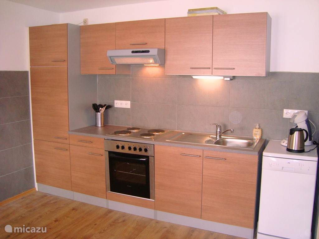 The new kitchen has a fridge, 4 ring ceramic hob with extractor hood, dishwasher and over. The Austrian dining area seats up to 5 people. There is ample crockery, cutlery, glasses and pans.