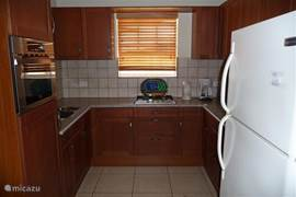 Large U-shaped kitchen with fridge-freezer, microwave, coffee maker and plenty of cutlery, plates, glasses etc.