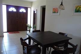 Large dining area overlooking tropical garden and adjacent to kitchen
