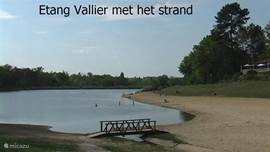 Etang Vallier flanked by a beach.