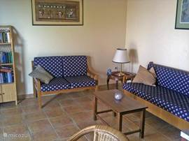 The sitting room has a colorful character with a love seat and a couch that can serve for a third guest. Sofa as