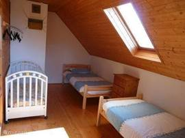 Bedroom with cot.