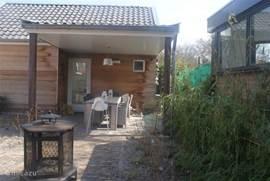 Veranda met Bbq, terrasverwarming en verlichting, 8 zitplaatsen en kinderstoel