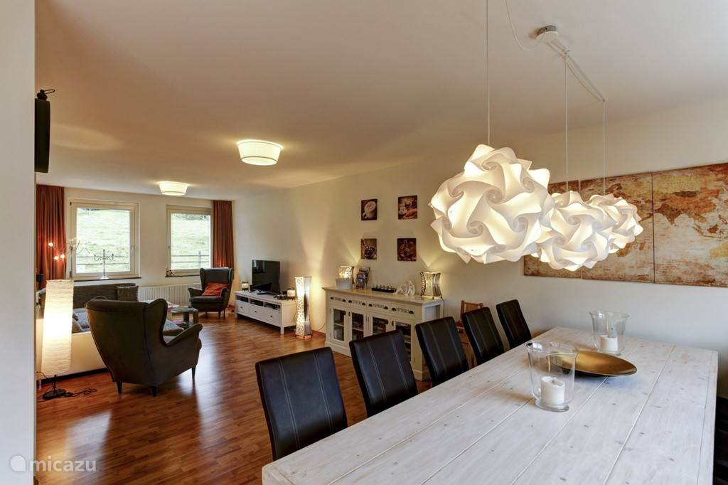 The living and dining areas form a whole and thereby also larger groups pleasant stay together in one room.