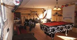 Indoor motorcycle parking with pool table, darts and table football