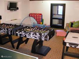 Game room with table tennis, air hockey and table football