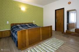 Slaapkamer in oud Slowaakse stijl.
