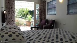 Bungalow Het Koetshuijs Curacao in Gaito, Curacao-Midden huren? | Micazu