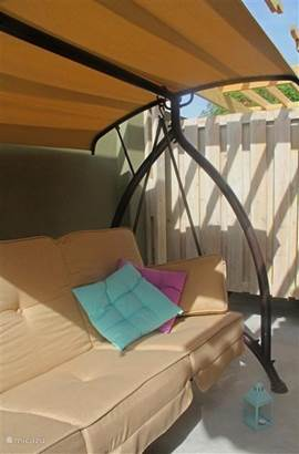 Swing sofa / bed in the private rear patio, accessible through the sliding door of the bedroom