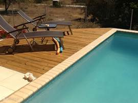 Pool deck with lounge chairs