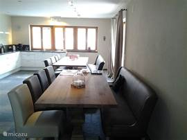 the dining area in the living room with open kitchen