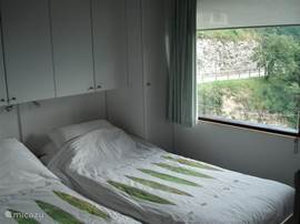 This is the bedroom with two single beds, which incidentally stuck together. One of the beds is longer.