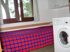 This is the single bedroom with wash (dry) machine.