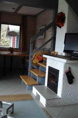 Cozy fireplace insert that is easy to operate. In addition, stairs to 1st floor.