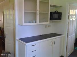 Another kitchen with extra storage and microwave.