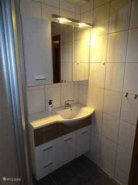 The bathroom has been completely refurbished. Vanity unit is equipped with an electrical outlet. There is a hairdryer available.