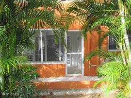 Lovely private apartment with covered terrace and mosquito netting in beautiful tropical garden