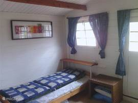 Renewed bedroom chalet with 2 single beds and one possibility for a 3rd bed.