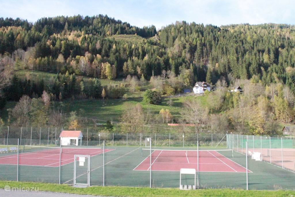 Outdoor and indoor tennis courts directly at the chalet.