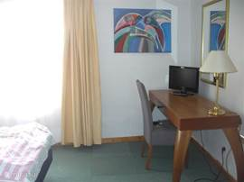 All double bedrooms are equipped with desk tv / dvd clock radio remote-controlled heater unit.