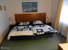 one of the three bedrooms with double springbox