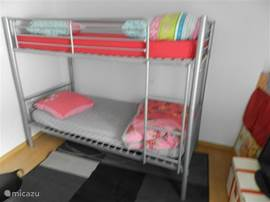1 bedroom with bunk beds.