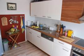 The kitchen is fully equipped. Oven, cooker, dishwasher, closet space and a nice view over garden and valley The kitchen is bright and spacious.