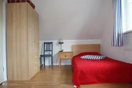 Slaapkamer met 2 een-persoons-ledikanten