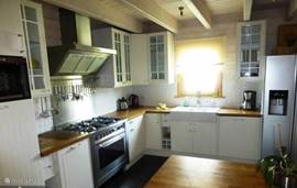 Luxury and extensive kitchen with American fridge with ice maker.
