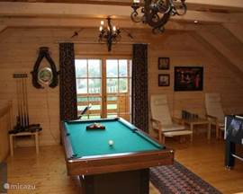 The loft with pool table and football game.