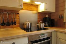 Open kitchen with dishwasher, microwave and induction hob