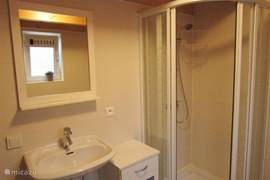 Bathroom with bath, separate shower and toilet.
