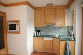 Open kitchen fully equipped.