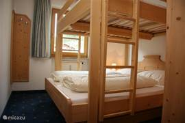 Bedroom with two bunk beds: The lower bed is a normal 2-bed, the upper  2-bed is 180 long.