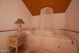 Torenkamer met twee bedden
