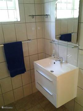 Bathroom with shower, equipped with heat (solar) and cold water