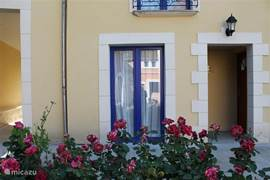 This is the entrance of the apartment / studio Le Hameau, situated on a typical French courtyard