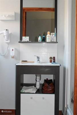 Bathroom with walk in shower, a sink, incl. Hairdryer and toiletries